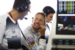 Jenson Button, McLaren talks to engineers in the garage
