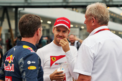 (L to R): Christian Horner, Red Bull Racing Team Principal with Sebastian Vettel, Ferrari and Dr Helmut Marko, Red Bull Motorsport Consultant