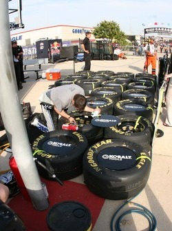 Crew member for Jimmie Johnson prepares tires