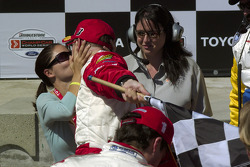 Race winner Sébastien Bourdais celebrates with girlfriend