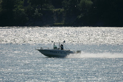 Police patrol on the St. Laurent river around the track