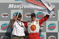 Pole winner Sébastien Bourdais celebrates with his dad Patrick