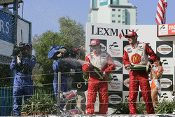Podium: champagne for Jimmy Vasser and Sébastien Bourdais