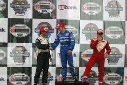 A.J. Allmendinger is congratulated by Bruno Junqueira