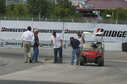 Track workers fill holes in corner 1