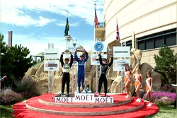 Podium: race winner A.J. Allmendinger with Bruno Junqueira and Dan Clarke