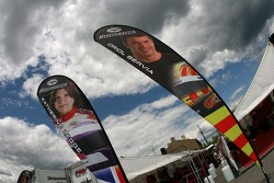 Flags of Katherine Legge and Oriol Servia