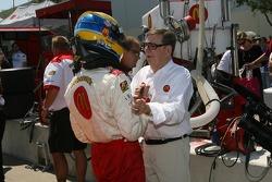 Provisional pole winner Sébastien Bourdais celebrates with Carl Haas