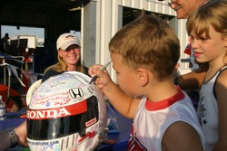 Fans sign Sarah Fisher's helmet