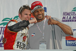 Victory lane: race winner Dan Wheldon celebrates