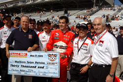 Team Penske crew members celebrate win at Pitstop challenge with Sam Hornish Jr.