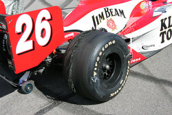 Shredded tires on the car of Dan Wheldon