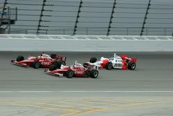 Dan Wheldon, Scott Dixon and Sam Hornish Jr. race for the lead