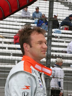Townsend Bell watches Buddy Rice's spin on the big screen