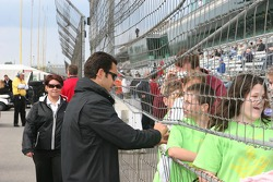 Helio Castroneves signs autographs for school children
