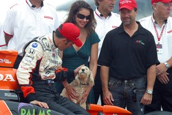 Dario Franchitti shares a laugh with his dog during the winner shoot