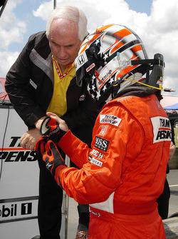 Sam Hornish Jr. takes instructions from Roger Penske