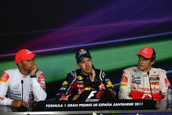 Lewis Hamilton, McLaren Mercedes with Sebastian Vettel, Red Bull Racing and Jenson Button, McLaren Mercedes