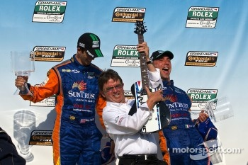 Victory Lane: race winner Max Angelelli, Ricky Taylor with Wayne Taylor on guitar
