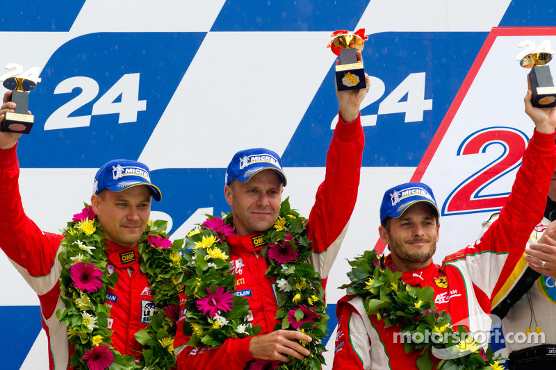 Fisichella on the podium at the Le Mans 24 Hours with Bruni and Vilander.