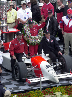 Helio Castroneves celebrating, with Roger Penske