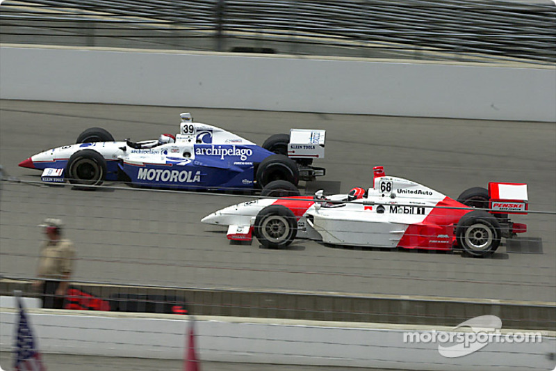 Michael Andretti and Helio Castroneves