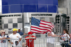 American flag flies in front of the winners podium