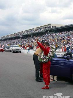 Race winner Gil de Ferran goes for victory lap
