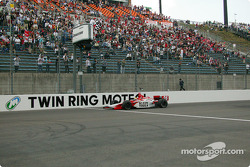 Dan Wheldon take the checkered flag