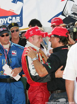Victory lane: Dan Wheldon celebrates with Michael Andretti