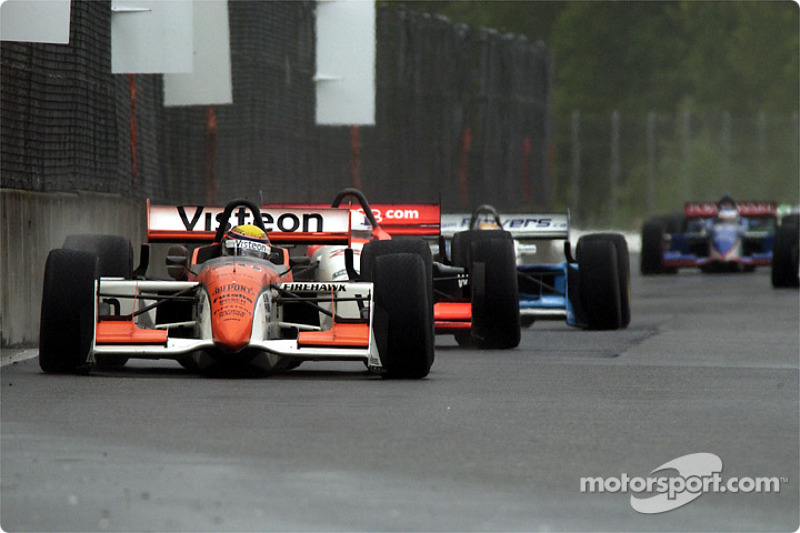 Roberto Moreno battling with Max Wilson and Patrick Carpentier