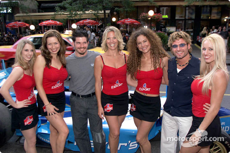 Patrick Carpentier and Alex Tagliani pose with the Molson Indy Girls at the Molson Export Blow-Out-Bash at Milestones in Downtown Toronto