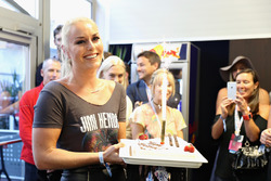 Skier Lindsey Vonn is given a birthday cake by Daniel Ricciardo, Red Bull Racing, Max Verstappen, Red Bull Racing and Christian Horner, Red Bull Racing Team Principal