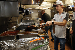 Esteban Gutierrez, Haas F1 Team works the grill at Mac's Speed Shop