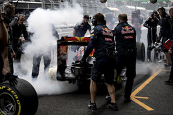 The brakes of Max Verstappen, Red Bull Racing RB12, catch fire in the pits