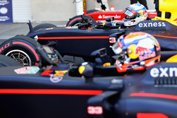 Fourth place qualifier Daniel Ricciardo, Red Bull Racing RB12 climbs out of his car next to team mate Max Verstappen, Red Bull Racing RB12 in parc ferme