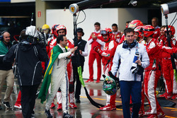 Felipe Massa, Williams is applauded by the Ferrari team in the pits after he retired from the race