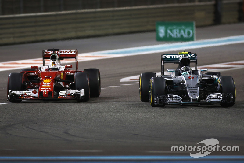 Себастьян Феттель, Ferrari SF16-H, и Нико Росберг, Mercedes AMG F1 W07 Hybrid
