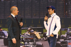 Lance Stroll visits the F1 Racing stand