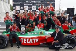Race winner Adrian Fernandez celebrates with his team
