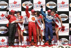 Podium: race winner Sébastien Bourdais with Jimmy Vasser and Patrick Carpentier