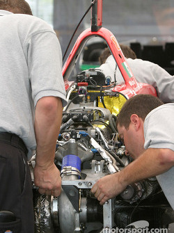 RuSPORT crew members assemble Michel Jourdain Jr.'s car