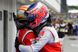 Race winner Jenson Button, McLaren Mercedes celebrates with Fernando Alonso, Scuderia Ferrari