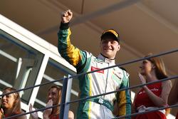 Valtteri Bottas celebrates winning the race and the drivers championship on the podium