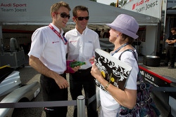 Timo Bernhard and Romain Dumas with a fan