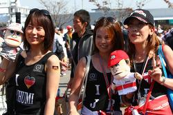 Fans of Michael Schumacher, Mercedes GP and Jenson Button, McLaren Mercedes