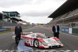 Jean-Claude Plassart, President of the Automobile Club de l'Ouest, and Vincent Beaumesnil, Sports Manager, in front of the Toyota 94 CV driven to second place in the 1994 Le Mans 24 Hours by Irvine-Martini-Krosnoff