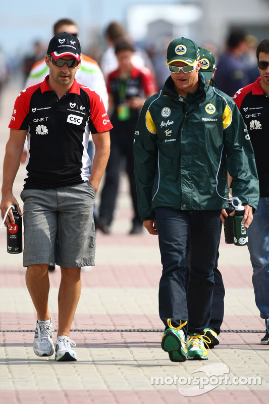 Timo Glock, Marussia Virgin Racing and Heikki Kovalainen, Team Lotus