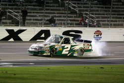 Kevin Harvick celebrates his win with a burn out on the front straight.