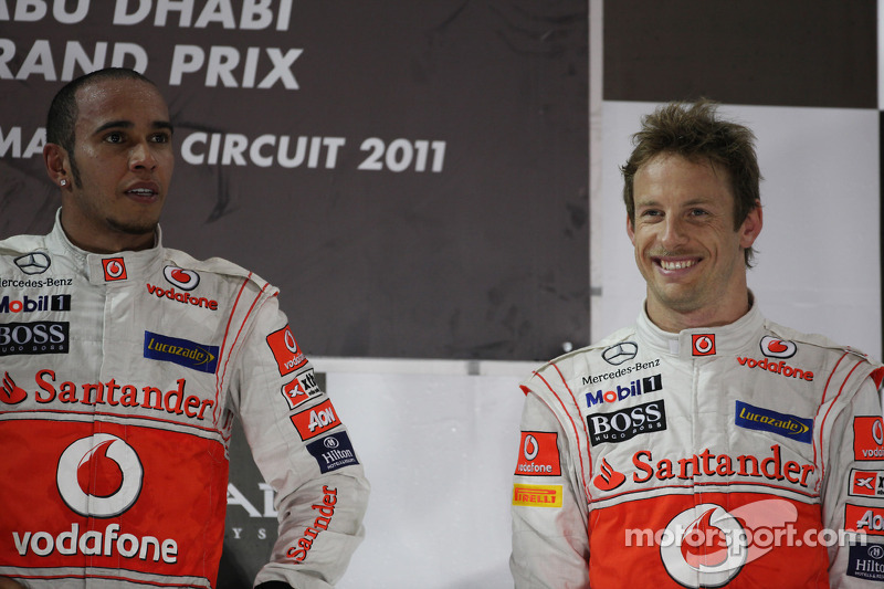 Podium: race winner Lewis Hamilton, McLaren Mercedes, third place Jenson Button, McLaren Mercedes